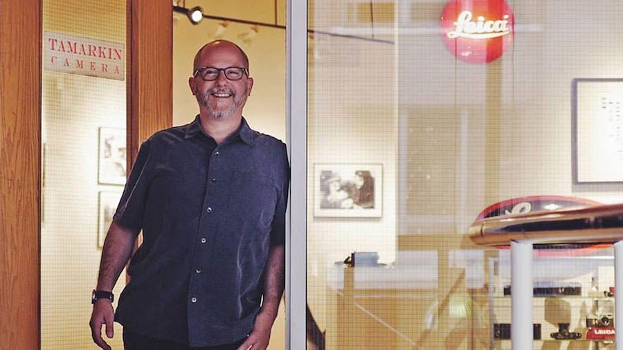 Dan Tamarkin standing in the doorway to Tamarkin Camera and The Rangefinder Gallery